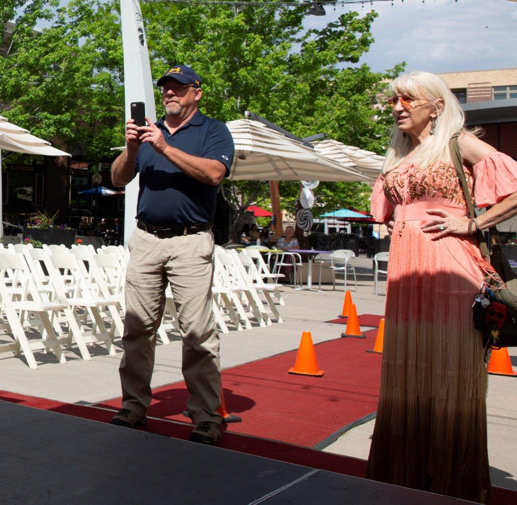 Jeanie Kochis, Colorado Miss Amazing Event partner sets up signage and more