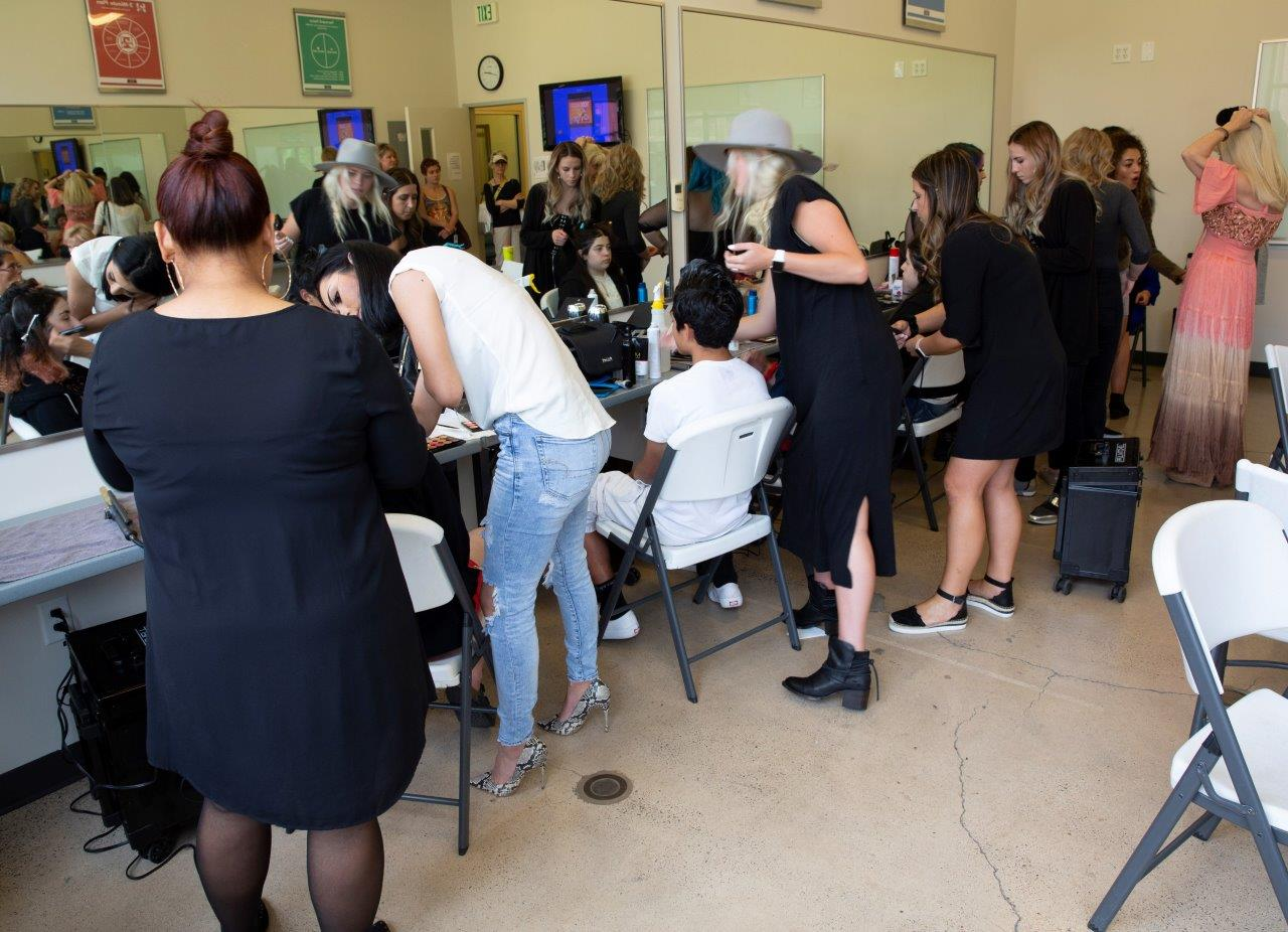 Paul Mitchell The School - students donate time and efforts with models