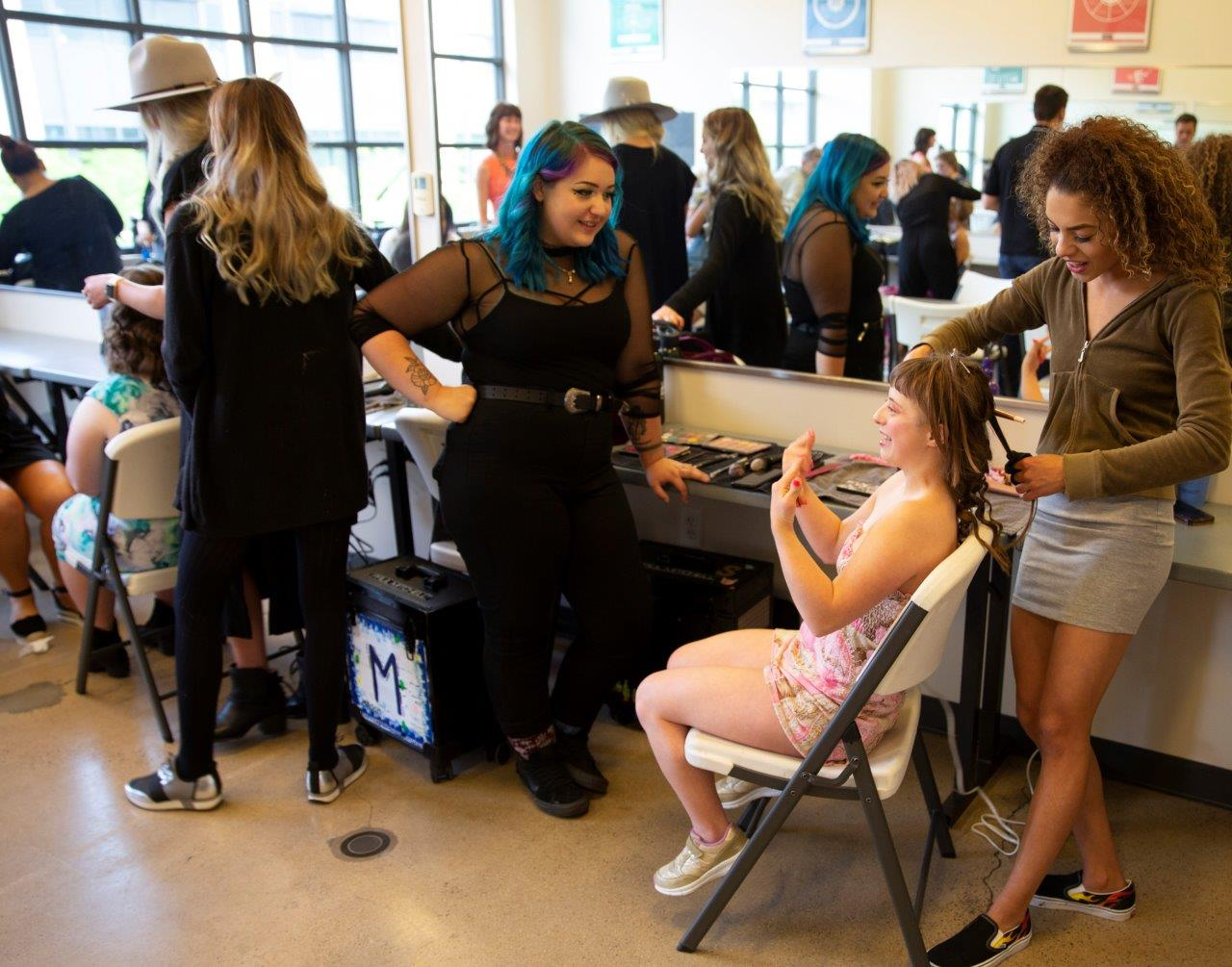Paul Mitchell /student stylists- supportive partner helping with outfits hair and makeup