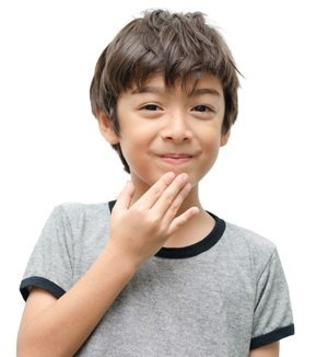 A boy giving the (ASL) American Sign Lanague hand sign for Thank You.